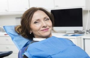 Woman Sitting in a Dentist Chair